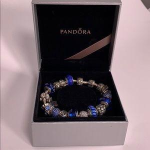 Pandora Bracelet with 18 Pandora Original Charms.